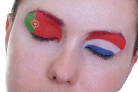 Young girl is dreaming about score in match between Portugal and Netherlands: EURO 2012, group B, 17th of June. Focus on eyelashes. photo