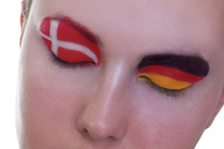Young girl is dreaming about score in match between Denmark and Germany: EURO 2012, group B, 17th of June. Focus on eyelashes. Stock Photo - 12510253