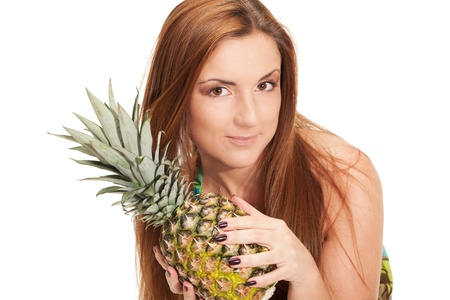 Girl in pineapple-like dress with pinapple in hands Stock Photo