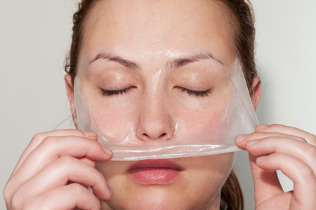 Woman removes cucumber mask like a snake changes skin