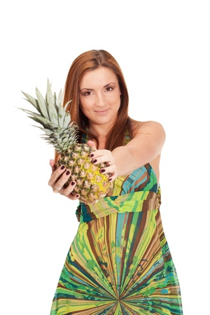 Girl in pineapple-like dress with pinapple in hands photo