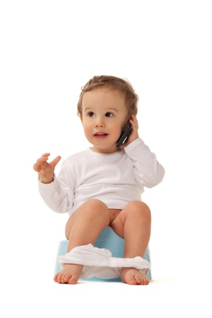 baby underwear: Boy sitting on a chamber bot playing with smartphone