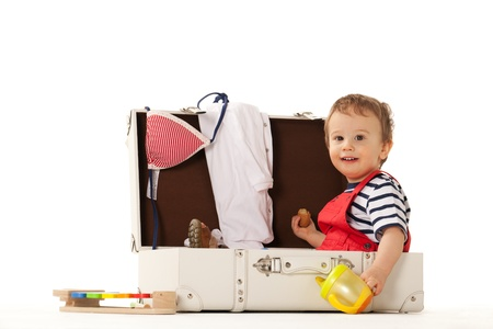 rompers: Boy in suitcase is ready for summer Stock Photo