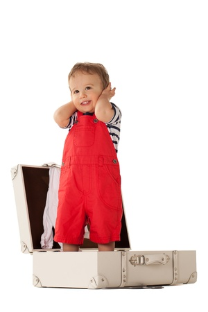 rompers: Little boy in suitcase wanting to go for vacations with you Stock Photo