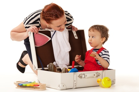 Little boy is sitting in the suitcase ready for vacations to start Stock Photo