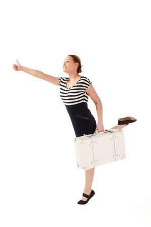 Woman with suitcase is trying to catch a taxi on isolated white background with shadows