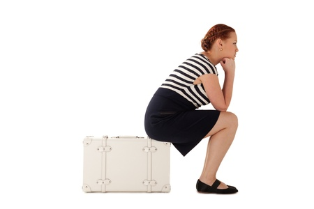 where to go: Woman is lost and sitting on suitcase thinking where to go then Stock Photo