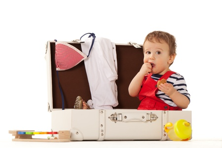 piece of luggage: Boy in suitcase is ready for summer Stock Photo