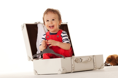 Little boy in suitcase wanting to go for vacations with you Stock Photo