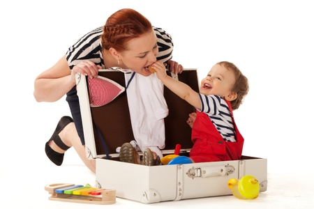 Little boy in suitcase wanting to go for vacations with you photo