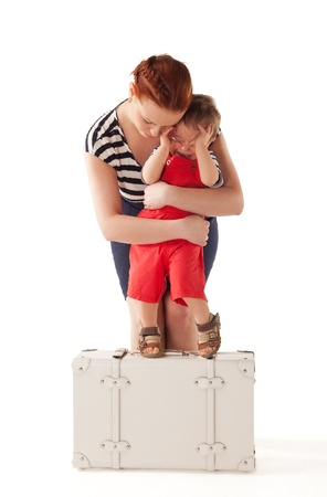 persuading: Little boy is crying and rejecting to go home after vacations