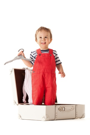 striped pajamas: Little boy packing stuff for vacations