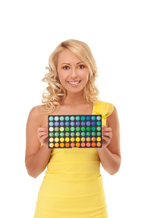 Smiling girl is holding shadow palette photo