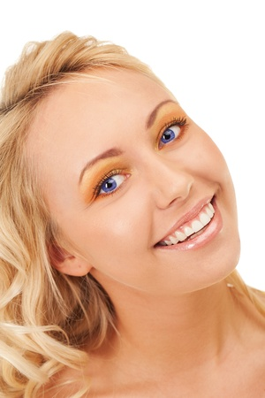 Happy smiling blond girl with blue eyes photo
