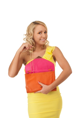 Young girl is taking chain out of handbag Stock Photo - 13282845