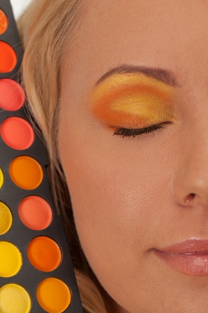 Young girl with orange and yellow make-up Stock Photo - 13282854