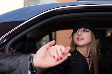 Lady accepting man's helping hand for getting out of the car Stock Photo - 13389676