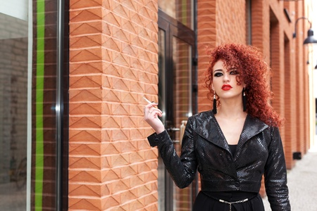 black girl smoking: Red haired girl bids defiance to you