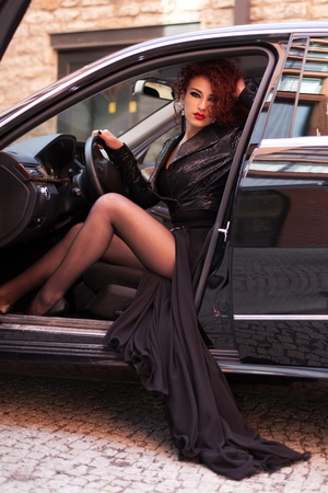 spread legs: Red haired girl in the luxury car
