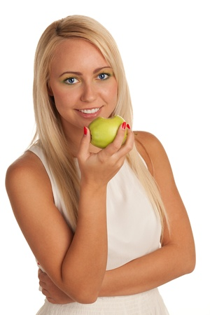 Smiling young blond girl eating apple photo