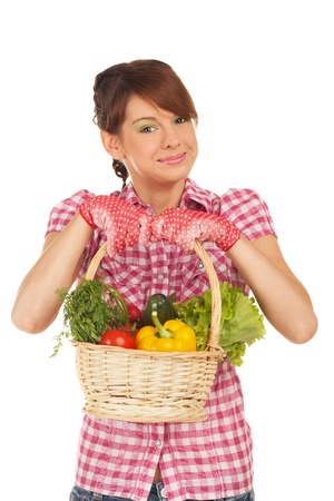 Young girl is back from the garden with full basket of vegetables photo