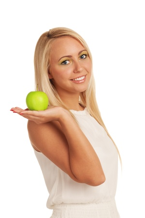 Smiling girl with apple on isolated white background photo