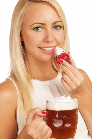 Seductive girl uses beer scum as whipped cream for strawberry photo