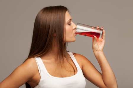 Girl drinking juice from glass photo
