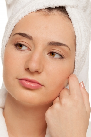 Portrait of a girl wrapped in a towel