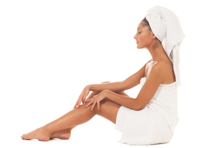 Girl checking if her skin is smooth enough after visiting spa procedure