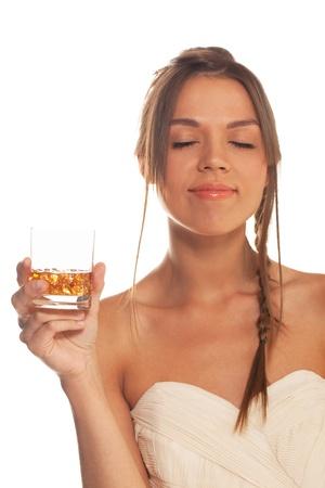 Girl with eyes closed enjoying hard liquor photo
