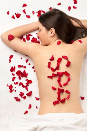 Girl with word SPA made of roses