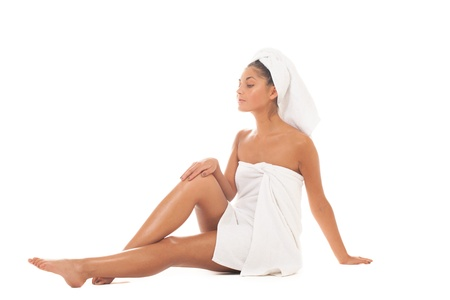 Girl checking if her skin is smooth enough after visiting spa procedure Stock Photo - 14779589