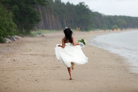 Runaway bride in the rain