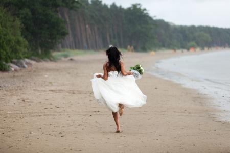 Runaway bride in the rain