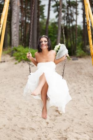 Runaway bride on a swing