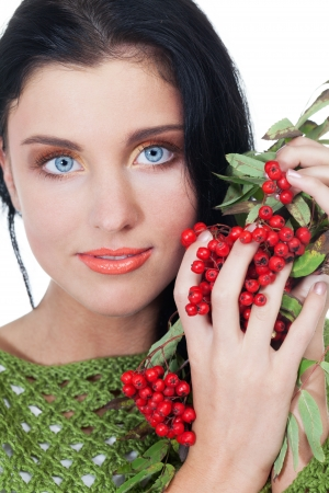 Girl with bunch of red rowanberry on isolated white photo