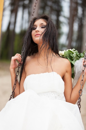 Runaway bride on the swing photo