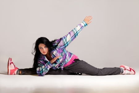 Young girl moving in the rhythm of hip-hop photo