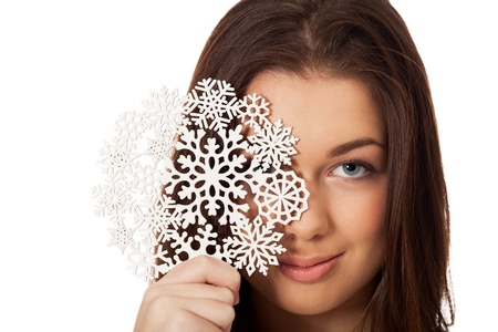 Girl with snowflake on isolated white Stock Photo - 16881721