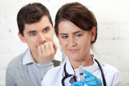Patient is afraid of injection nurse is about to make Stock Photo - 16881728