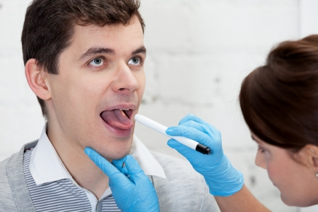 tonsillitis: Doctor is checking throat of a patient