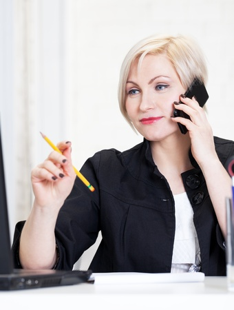 Business woman working hard in office photo