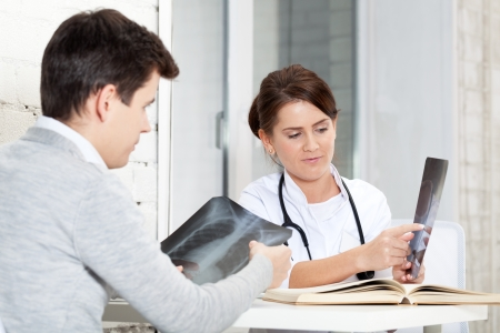 Patient and doctor discussing X-Ray results photo