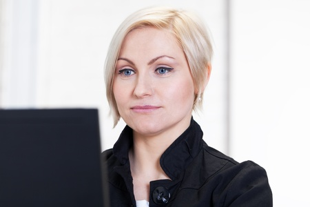 Portrait of woman working with computer photo