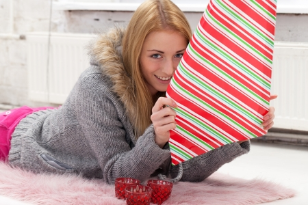 Girl with decoration paper preparing gifts Stock Photo - 17416174