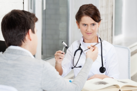 Patient joshing doctor with nail photo