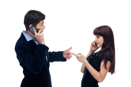 Man and woman asking if they are calling each other photo