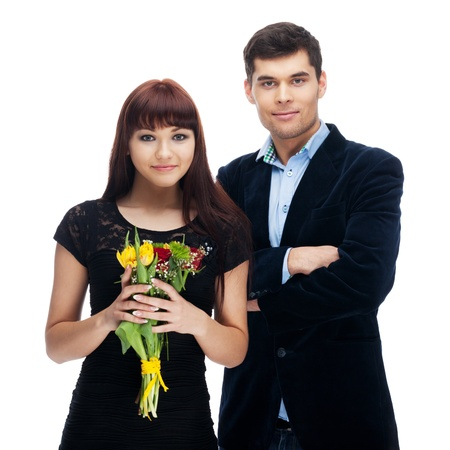 Couple with flowers on isolated white Stock Photo - 17796187