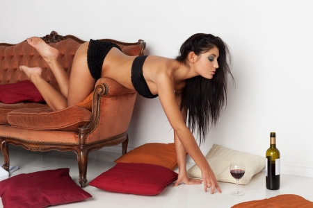 Attractive girl is seduced by red wine
